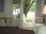 King Deluxe Suite at Footbridge Motel in Ogunquit, Maine. With walkout deck.