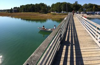 Walking bridge with Footbridge Beach parking-lot in Ogunquit, Maine