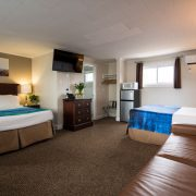 Perkins Cove Suite with Queen bed, Double bed, and Sofa bed. (Sleeps 6)