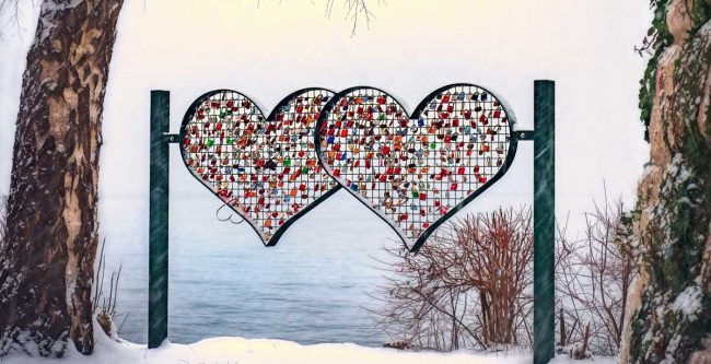 Heart sculpture near the water in winter