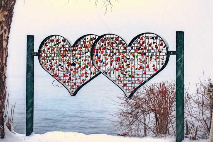 Heart sculpture near the water in winter