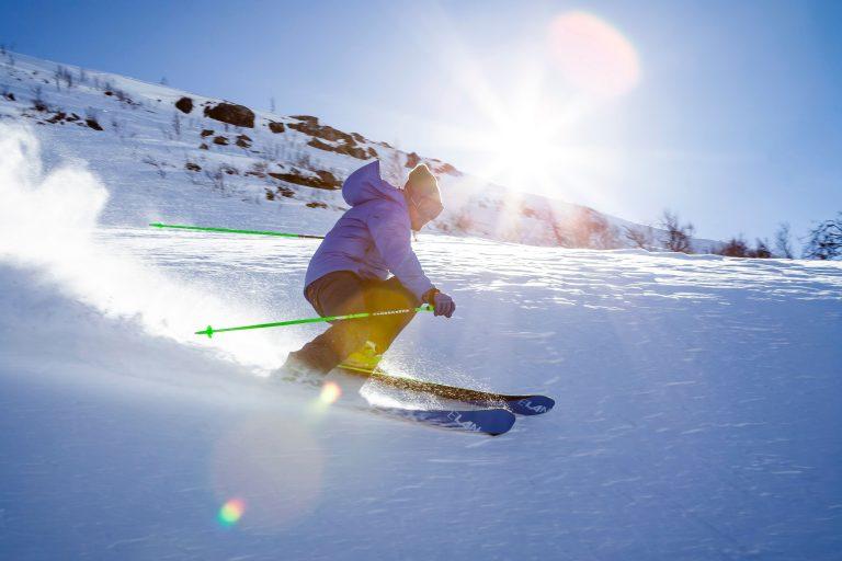 Man skiing down a mountain of fresh powder