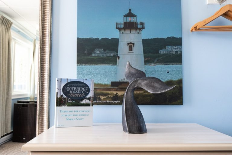 Footbridge Motel Room 08 | Whale Tail Decoration w/ Painting Behind