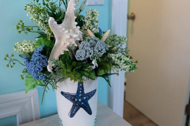 Footbridge Motel Room 15 | Seashell Base w/ Plant Decoration