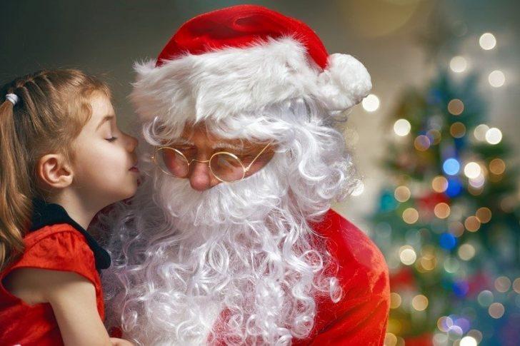 little girl kissing Santa