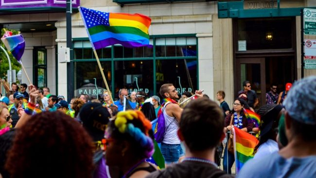 People gathered on the streets with rainbow flags for an LGBTQ event